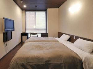 お茶の水ホテル昇龍館にあるベッド