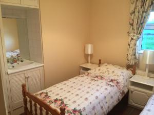 A bed or beds in a room at Sandycove Self Catering