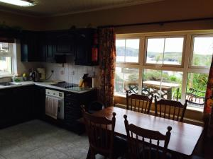 A kitchen or kitchenette at Sandycove Self Catering