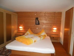 Ein Bett oder Betten in einem Zimmer der Unterkunft Alpenhaus Waldberg