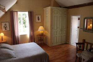 Un ou plusieurs lits dans un hébergement de l'établissement Les Jardins de L'Aulnaie
