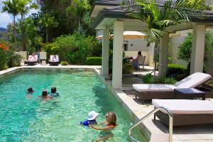 The swimming pool at or near Portside Whitsunday Luxury Holiday Apartments