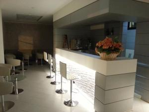 The lounge or bar area at Albergo Aquila