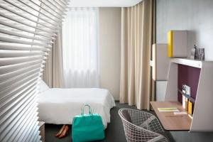 A television and/or entertainment center at Okko Hotels Lyon Pont Lafayette