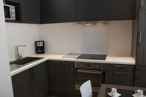 A kitchen or kitchenette at Une Pause a Signes