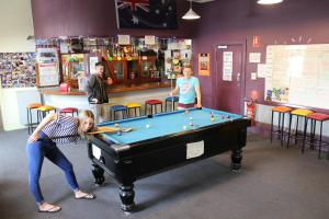 A pool table at Backpack Oz