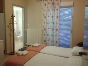 Ein Bett oder Betten in einem Zimmer der Unterkunft Hotel Isidora