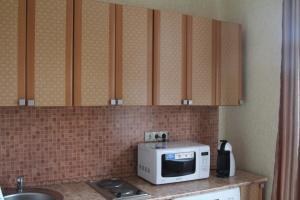 Кухня или мини-кухня в Апартаменты Шер
