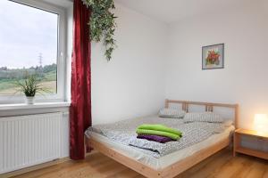 Łóżko lub łóżka w pokoju w obiekcie Villa Apia