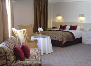A bed or beds in a room at Perisher Manor Hotel