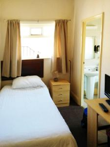 A bed or beds in a room at The County Hotel
