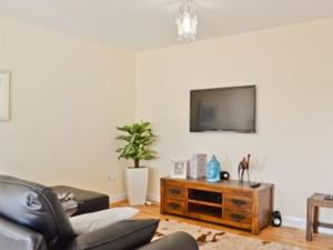 A television and/or entertainment centre at The Penthouse- The Kingsley Collection