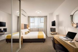 A bed or beds in a room at Quest King William South