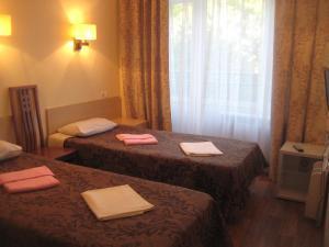 Кровать или кровати в номере Санаторий Бобачевская Роща