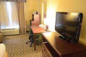 A television and/or entertainment center at Holiday Inn Express Hotel & Suites Houston-Downtown Convention Center