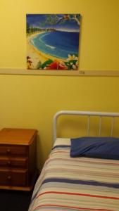 A bed or beds in a room at Gecko's Rest Budget Accommodation & Backpackers