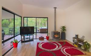 A television and/or entertainment center at Babbling Brook Retreat