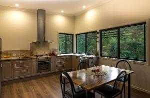 A kitchen or kitchenette at Babbling Brook Retreat