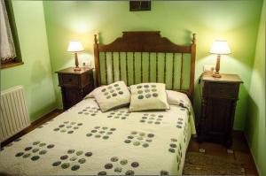 Cama o camas de una habitación en Casas Rurales Taramundi Verde