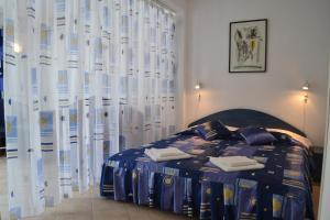 Кровать или кровати в номере Family Hotel Magnolia