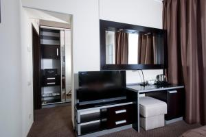 A television and/or entertainment center at Hotel & Spa Vikey