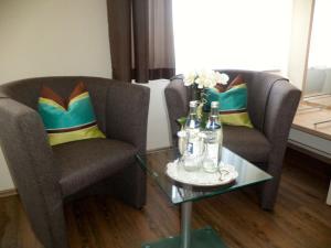 Ein Sitzbereich in der Unterkunft Gasthof Goldenes Lamm