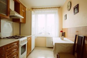 Кухня или мини-кухня в ApartLux on Krasnaya Presnya
