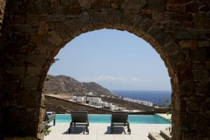 The swimming pool at or near Niriides Luxury Homes