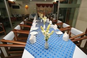 A restaurant or other place to eat at Red Chillies Restaurant and Guest house