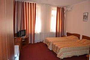 Кровать или кровати в номере Отель Булак