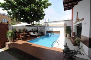 The swimming pool at or near Portal Da Praia Hotel
