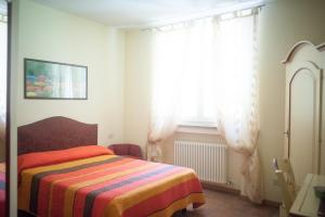 A bed or beds in a room at Agriturismo Il Mondo