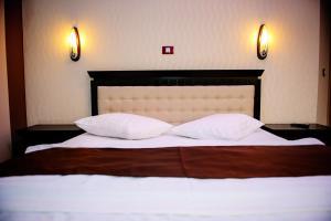 Un pat sau paturi într-o cameră la Vila HD