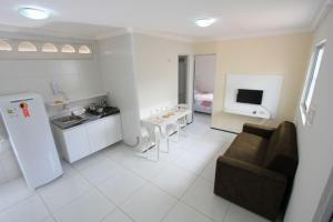 A kitchen or kitchenette at Residencial Santa Lucia