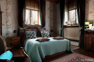 Ein Bett oder Betten in einem Zimmer der Unterkunft B&B De Vijf Zuilen