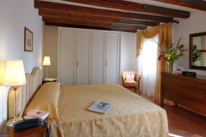 Letto o letti in una camera di Residence Corte Grimani