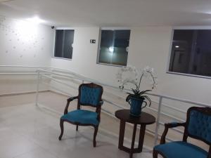 Uma área de estar em San Marino Residence