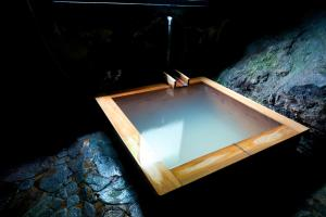 The swimming pool at or near Onsen Guesthouse HAKONE TENT