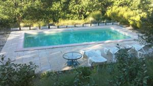 The swimming pool at or near L'Aubépine