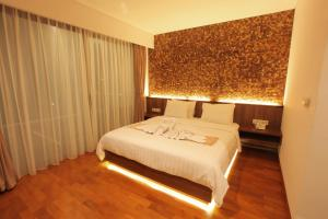 A bed or beds in a room at Aquarius Star Hotel