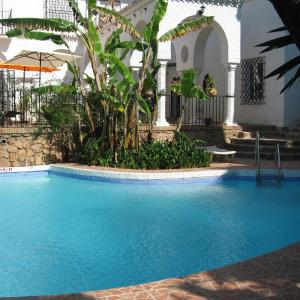 The swimming pool at or near Hotel Residencia Miami