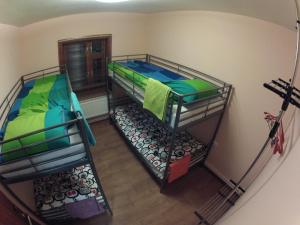 A bunk bed or bunk beds in a room at Serpeyka Guesthouse