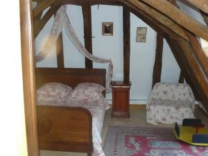 A bed or beds in a room at Chambres d'Hôtes & Gites Pouget