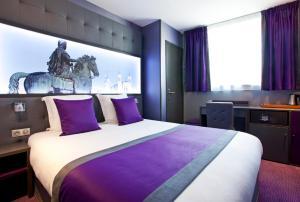 Un ou plusieurs lits dans un hébergement de l'établissement Hotel des Savoies Lyon Perrache