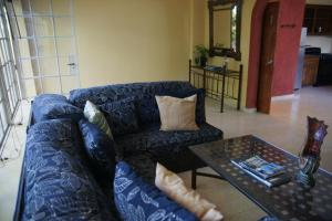 A seating area at Corail Suites