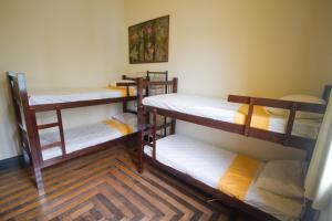 A bunk bed or bunk beds in a room at Guanaaní Hostel