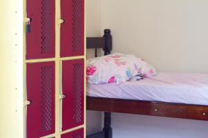 A bed or beds in a room at Guanaaní Hostel