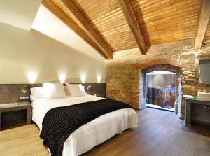 Cama o camas de una habitación en Fonda La Masia Del Sola