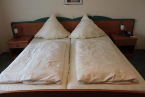 Ein Bett oder Betten in einem Zimmer der Unterkunft Hotel Ideal