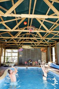 The swimming pool at or near Lovedale Cottages Hunter Valley